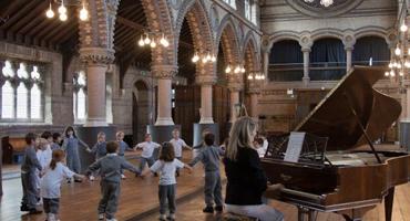 Kids dancing inside Hampstead Hill School