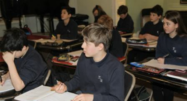 Mixed group of pupils sat at their desks at Trevor Roberts School in Swiss Cottage.