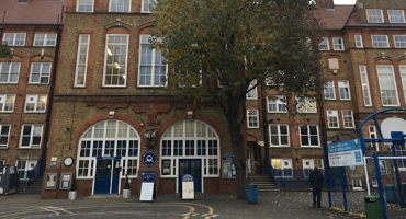 A historic front of the school entrance for Carlton Primary School on an autumn afternoon.