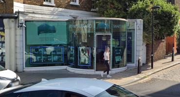 Full glass cylindrical modern Martyn Gerrard building in Kentish Town.