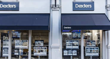Outside of Dexters in Kentish Town with blue coverings on top of the modern windows.