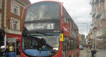 The number 83 red London Hendon bus travelling to Charing Cross.