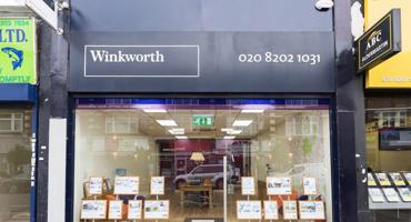 Outside of Winkworth estate agent in Hendon.