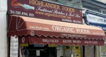 Red shop front of Highland Foods in Mill Hill who sell exotic meats