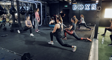 Group of 12 women in a sweat class at Boxr gym in Mill Hill.