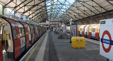 Platform with two tube trains at Edgware underground station.