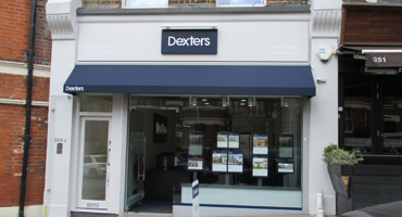 The shop front of Dexters branded in navy blue in West Hampstead.