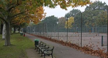 Empty tennis courts at lyttelton fields on an autumn afternoon.