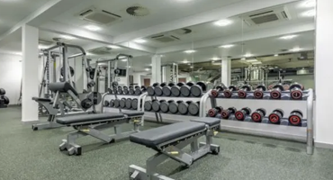 Exercises benches and a full-length weights rack at Archway Leisure Centre.