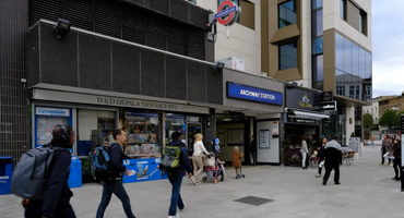 Busy commuters walking into Archway tube station.