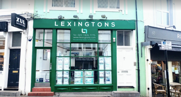 Outside of Lexingtons Estate agents in between an architecture firm and an independent bakery.
