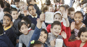 Pupils celebrating 60th anniversary at Queenswell Junior in Totteridge.
