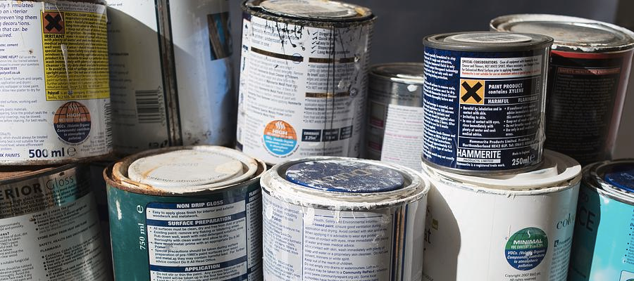 A stack of old paint tins