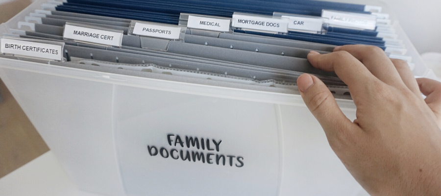 Someone looking through family documents in a file