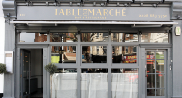 Chic white storefront for Table Du Marche in East Finchley