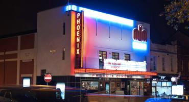 Neon lit exterior of Phoenix Cinema in East Finchley.