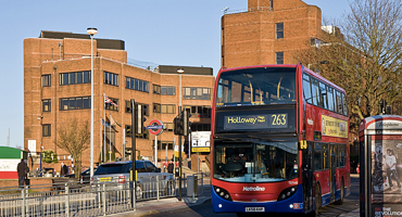 263 London red bus passing by East Finchley tube station.