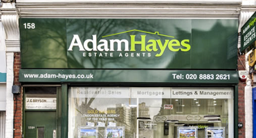 Branded store front for Adam Hayes in East FInchley.