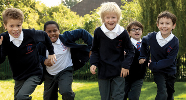 Group of boys running around Theresas Primary School in Finchley.