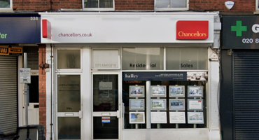 White and red shop front for Chancellors Estate Agents in Finchley.