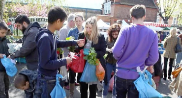 People shopping at Queens Park Farmers' Market in Kilburn.