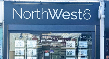 Blue shop front for North West 6 in Kilburn.