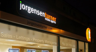 Black and orange shopfront for Jorgensen Turner in Kilburn.