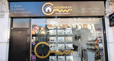 Black shop exterior for Golden Key in Kilburn.