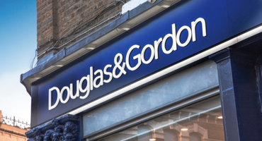 Blue and white shop front for Douglas Gordon in Fulham.