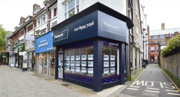 Blue and white shopfront for Winkworth in Chiswick.