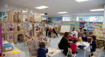 Children aged 2 to 7 years old sitting at their desks playing with toys at Herne Hill School in South London.