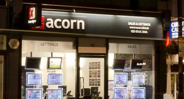 Black shop front for Acorn estate agent in Dulwich.