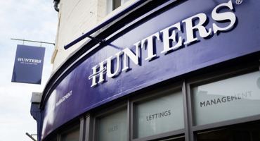 Blue shop front for Hunters estate agent in South London.