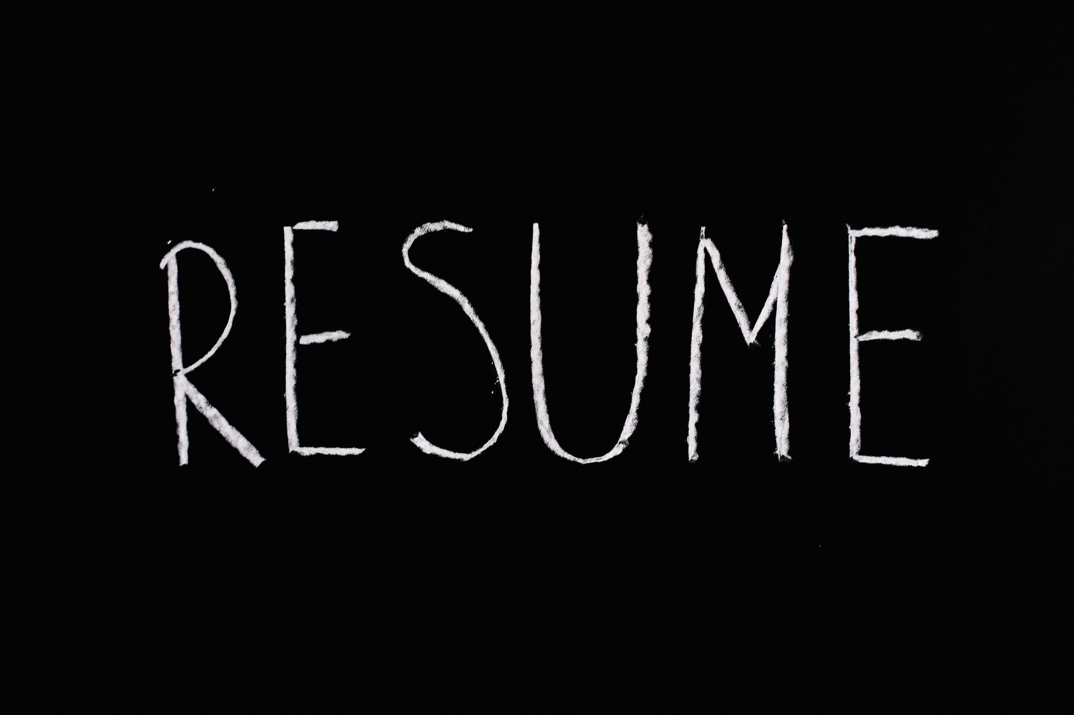 The word resume is written in white on black background, that looks like a chalkboard.