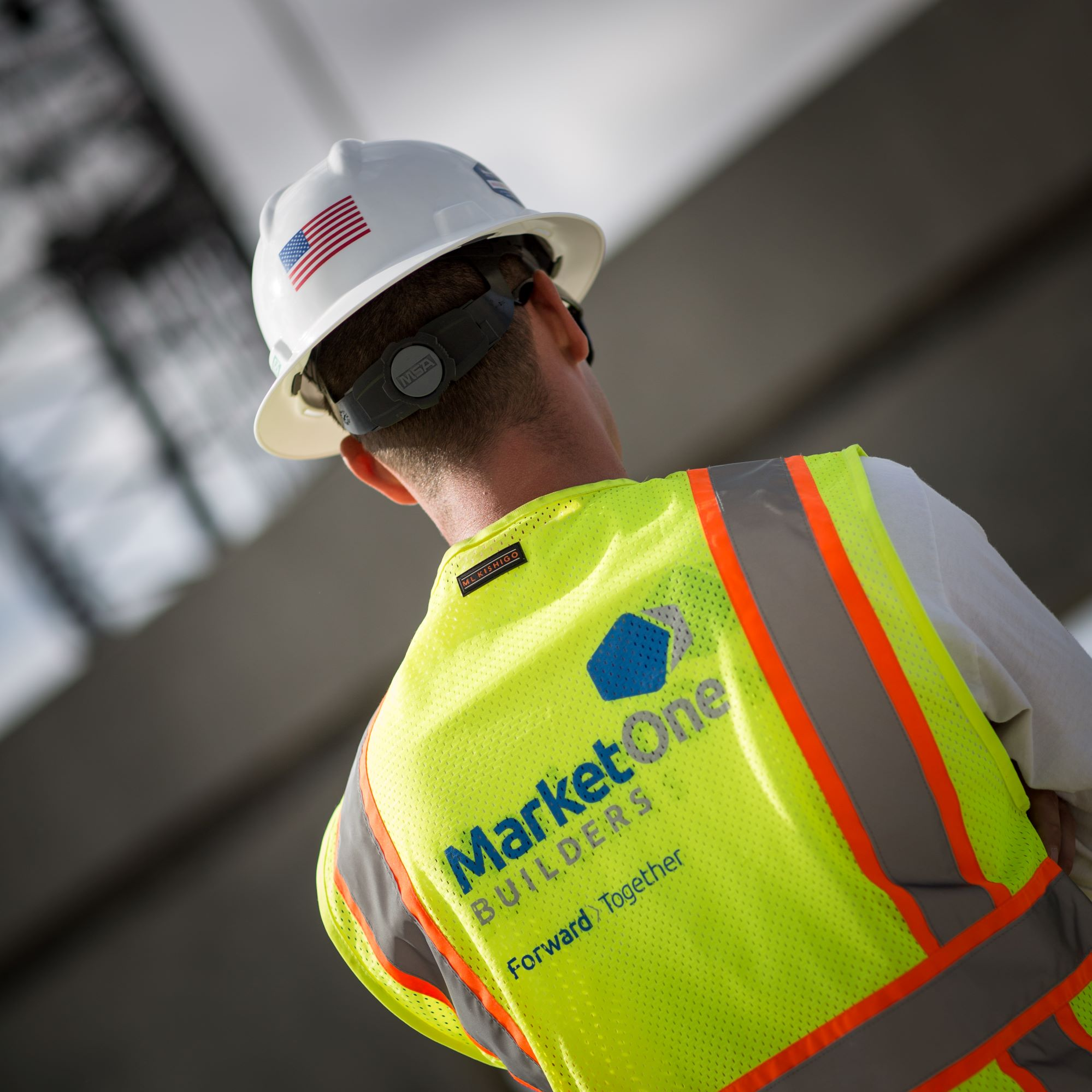 MarketOne construction worker with back to camera
