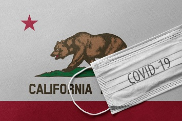 California flag and a covid-19 face mask