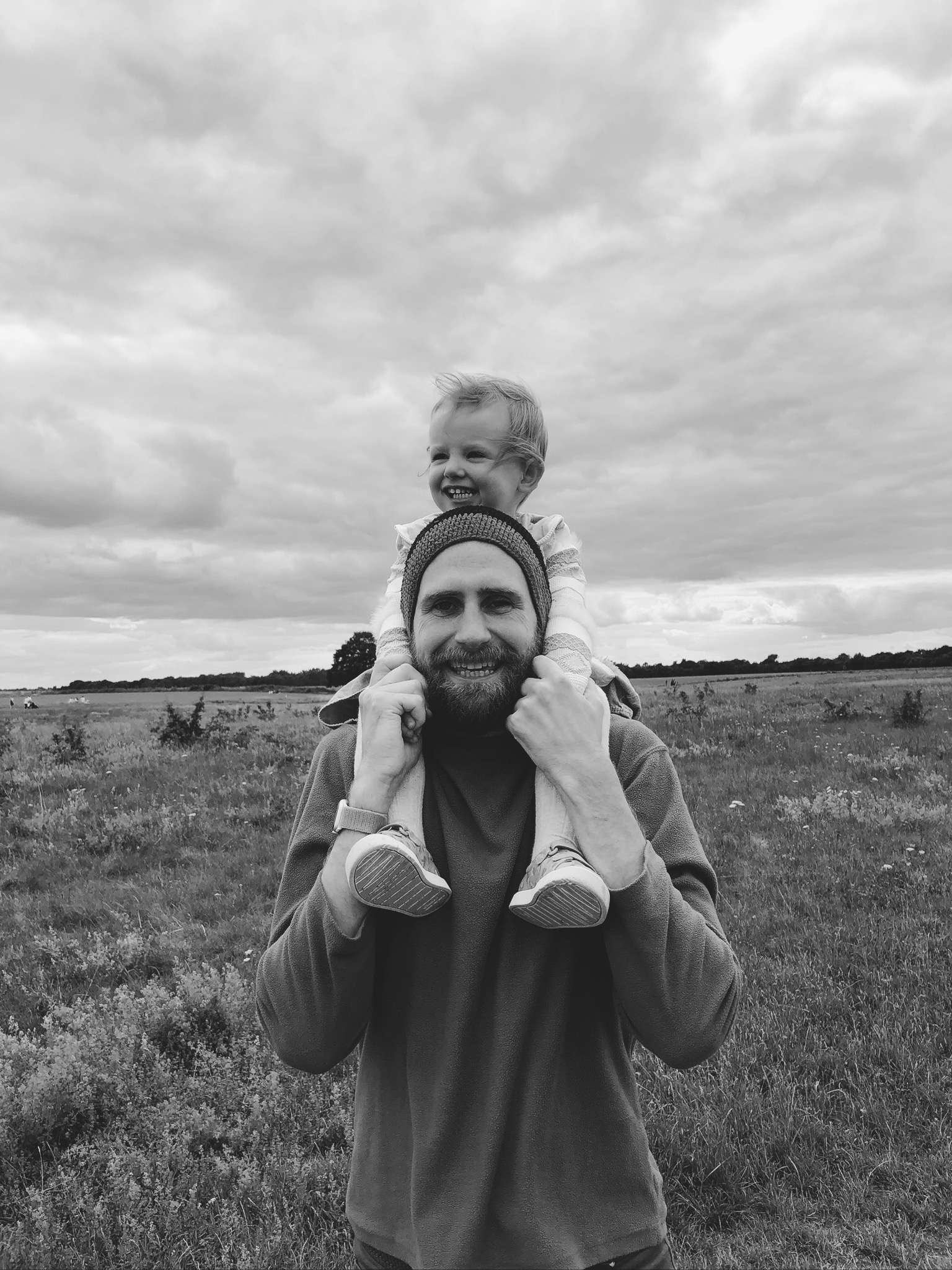 A picture of David Matthams with his daughter on his shoulders.