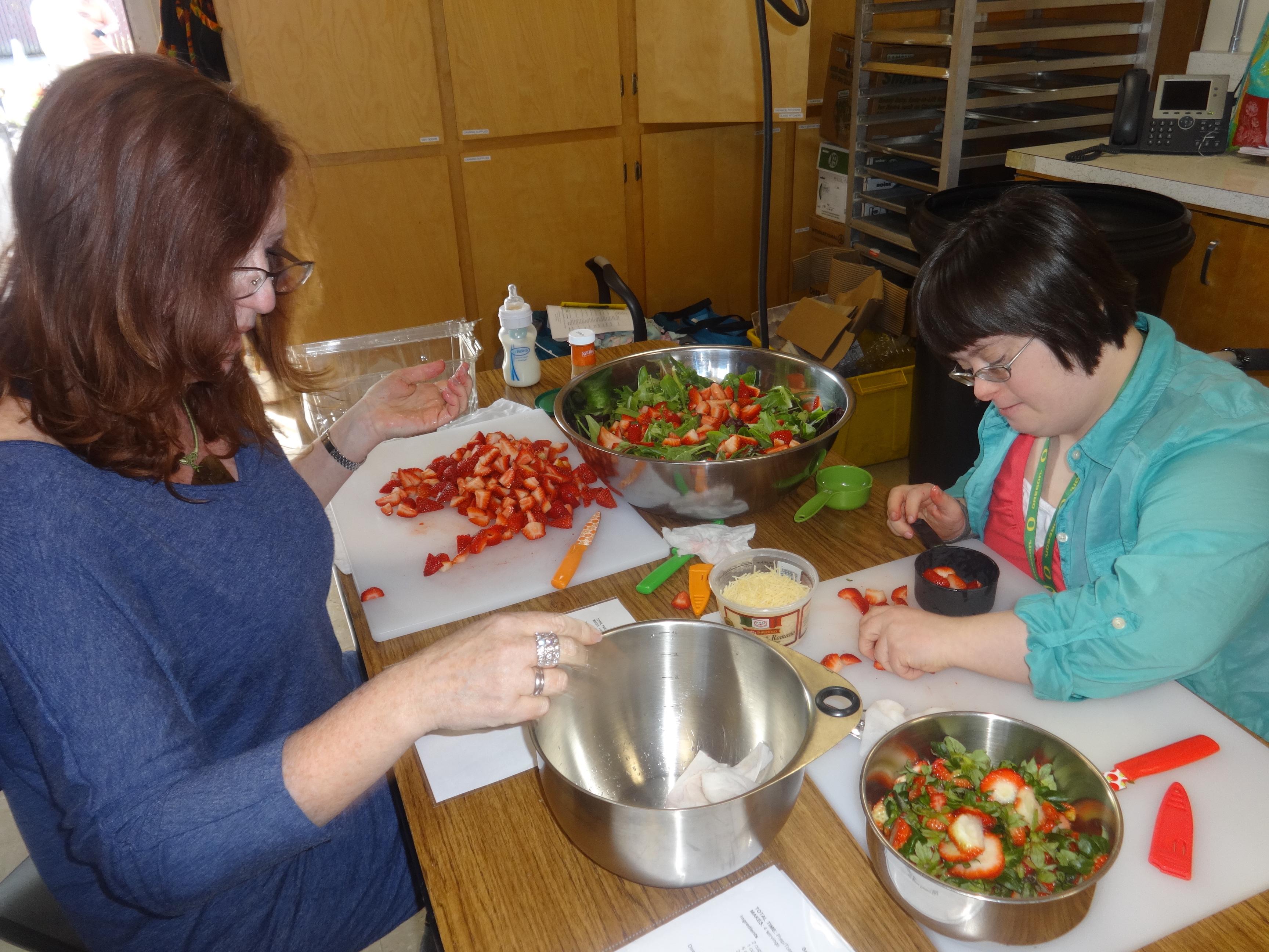 Two people making salad