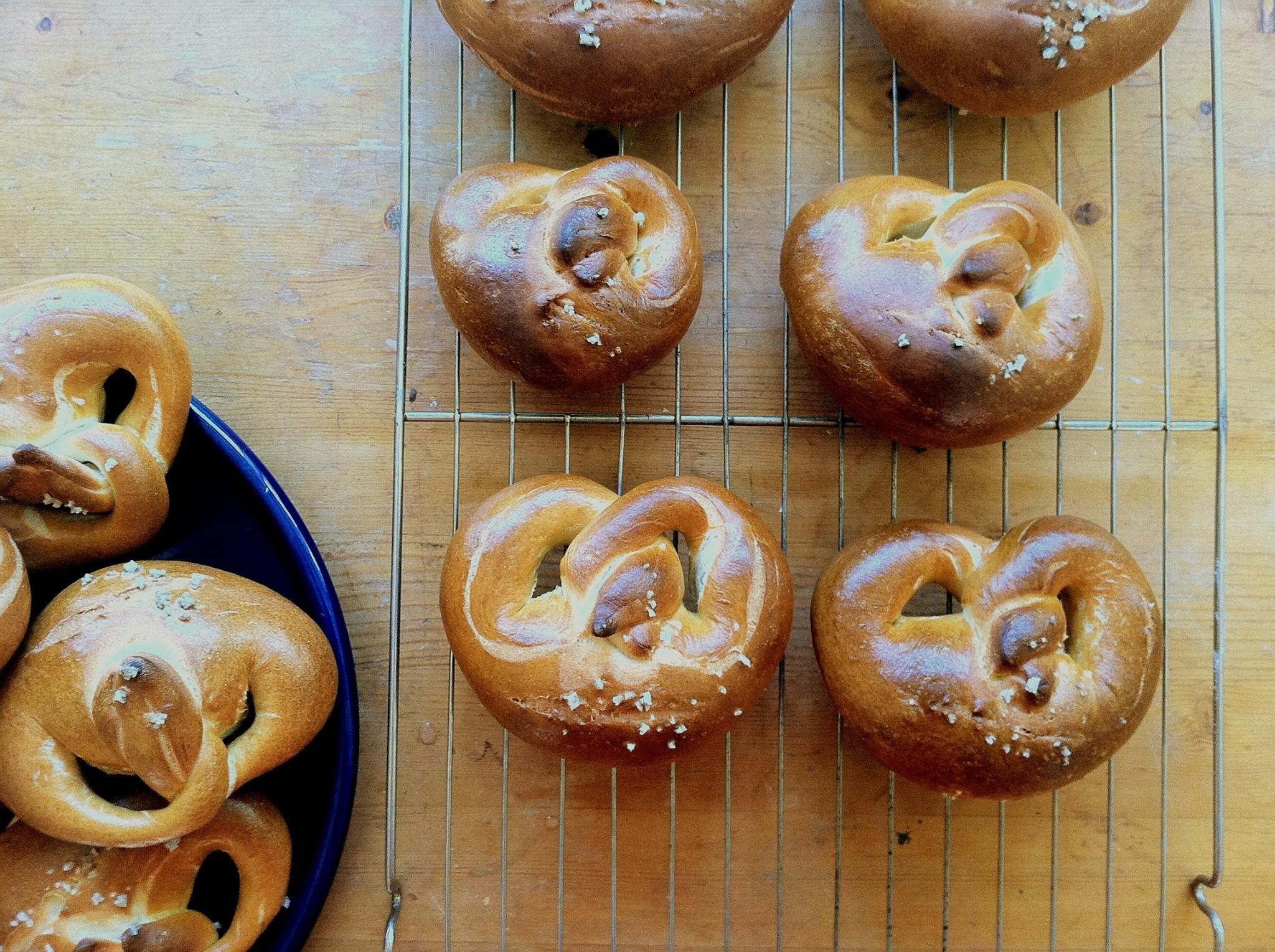 Homemade pretzels on a baking rack.
