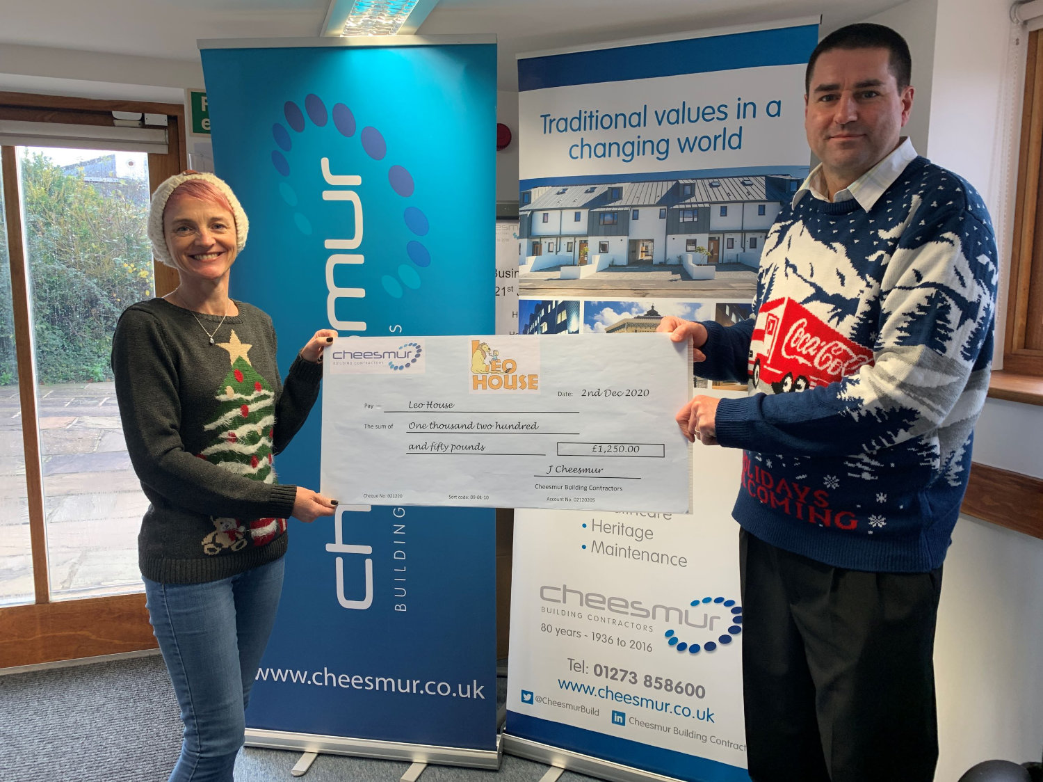 Cheque being donated to Leo House