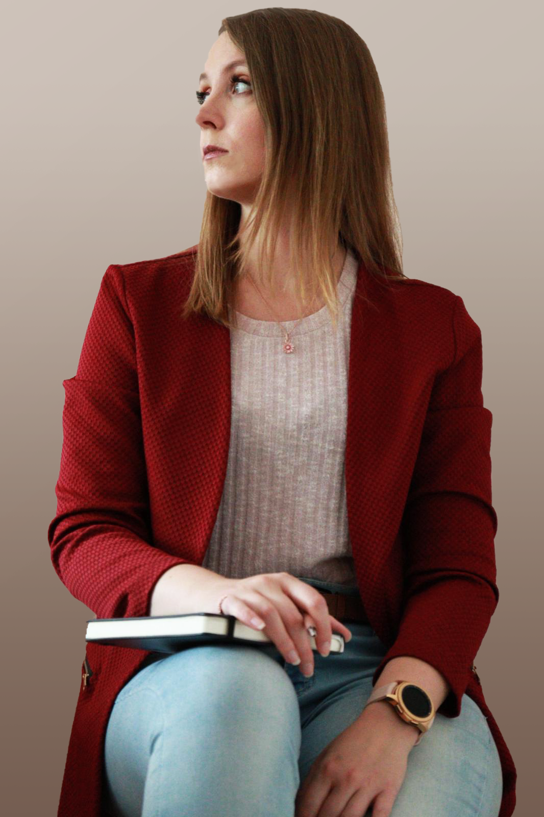 picture of the artist, Jaqueline Martin, with the head turned to the left in a red jacket