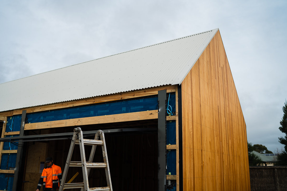 Granted Constructions - Melbourne - Building Process - Wooden Exterior Peaked Roof and Ladders