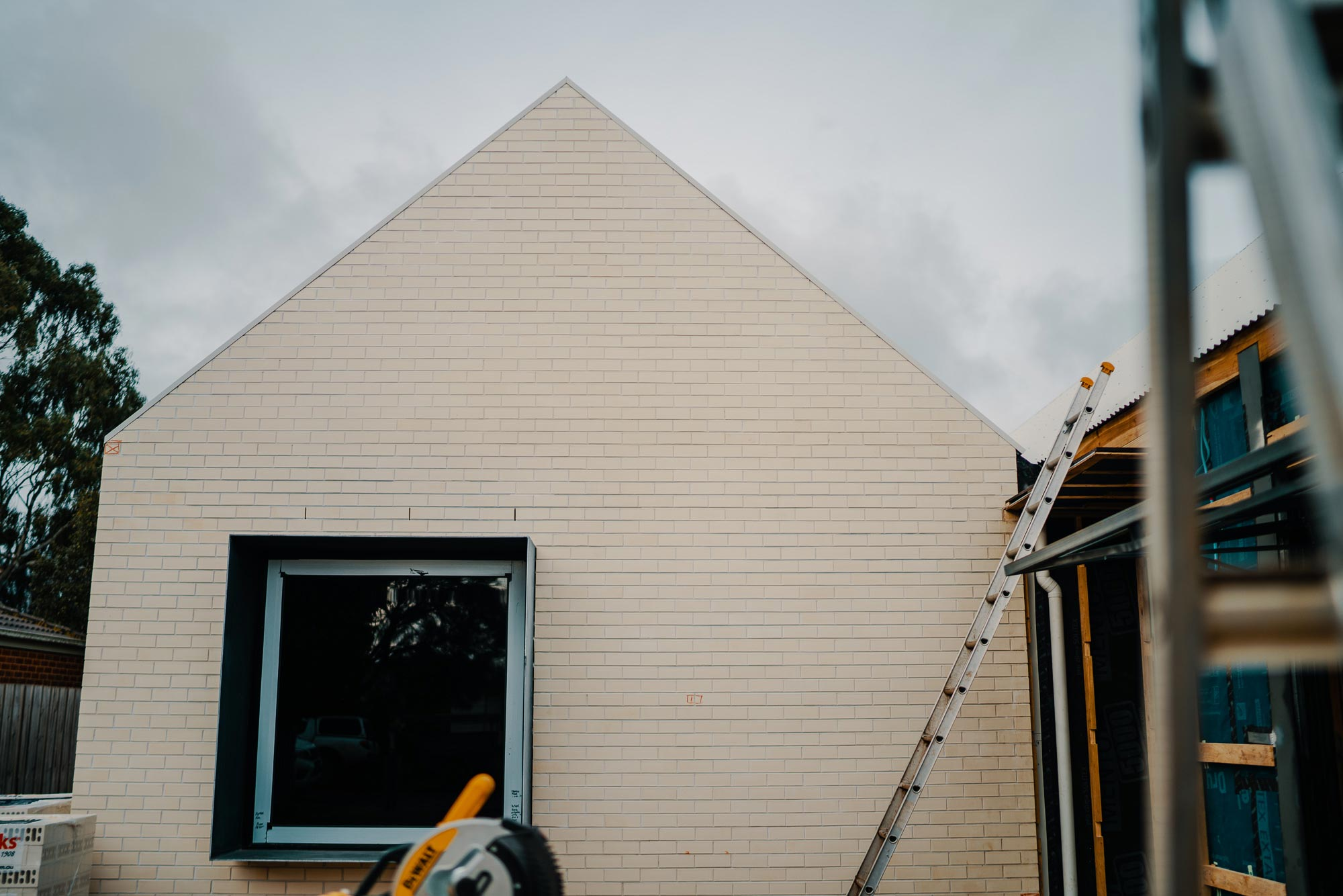 Granted Constructions - Melbourne - Building Process - Brick Peaked Roof and Ladders