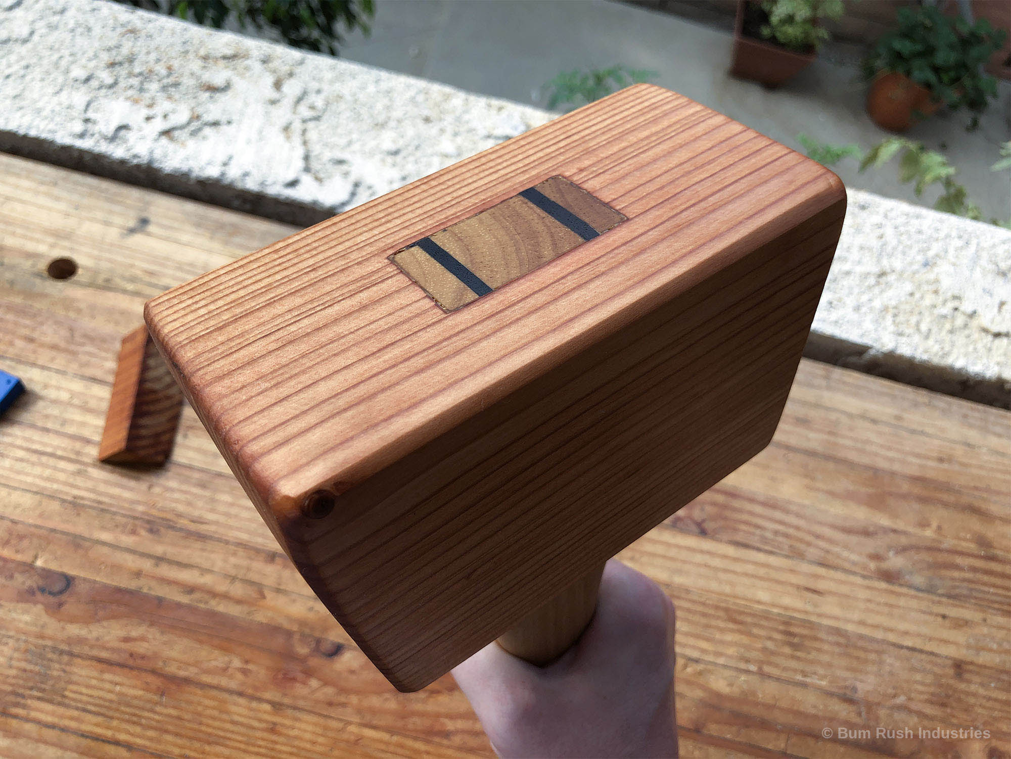 Woodworking mallet with walnut wedges