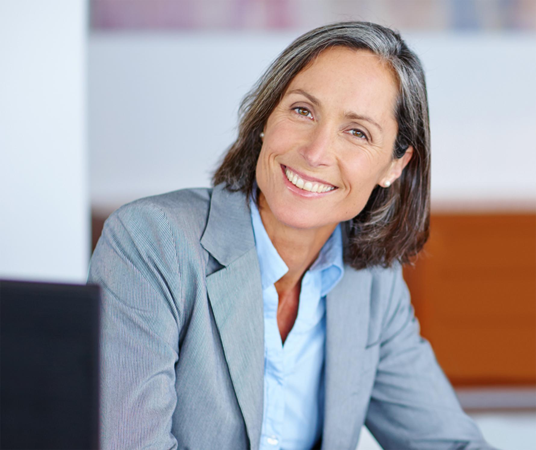 Photograph of a female, caucasian, executive.