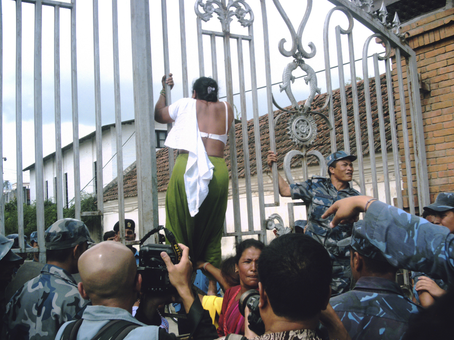 "Kathmandu, 2007 When other attempts to press the demands of Dalit communities had failed, Uma Devi Badi stages a ""petticoat protest"" as a last-ditch effort outside Singha Durbar, the government secretariat to symbolize the stripping of the Badi community's dignity."