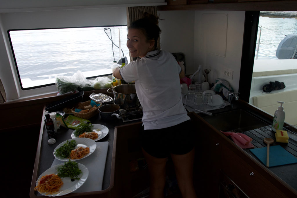 Our hostess preparing pasta in small boat kitchen