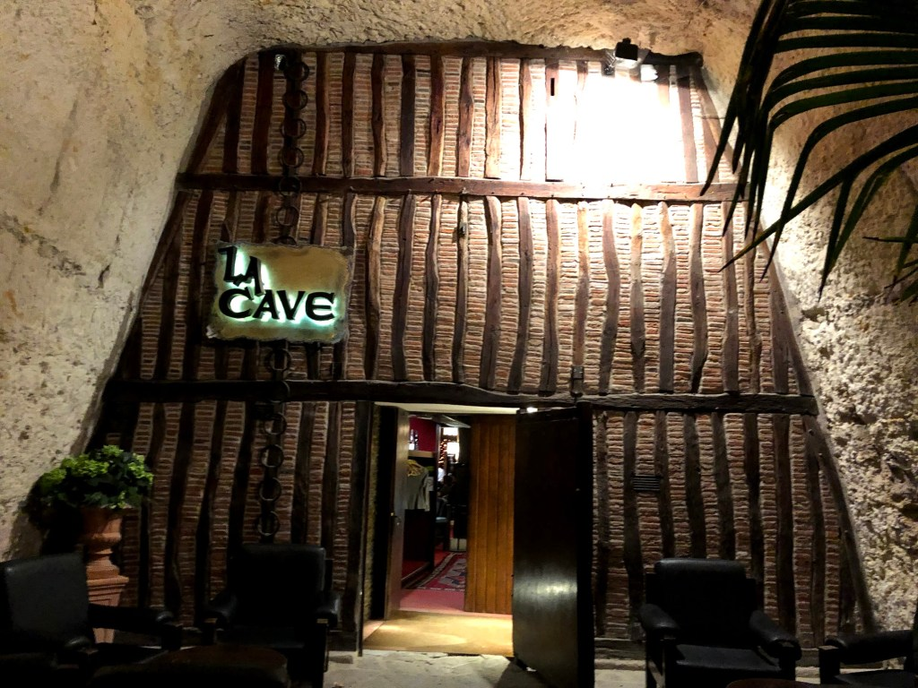 "A restaurant built into a stone hill, called ""La Cave."""
