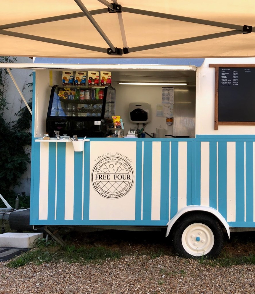 """Blue and white food truck reading """"Free Four."""""""