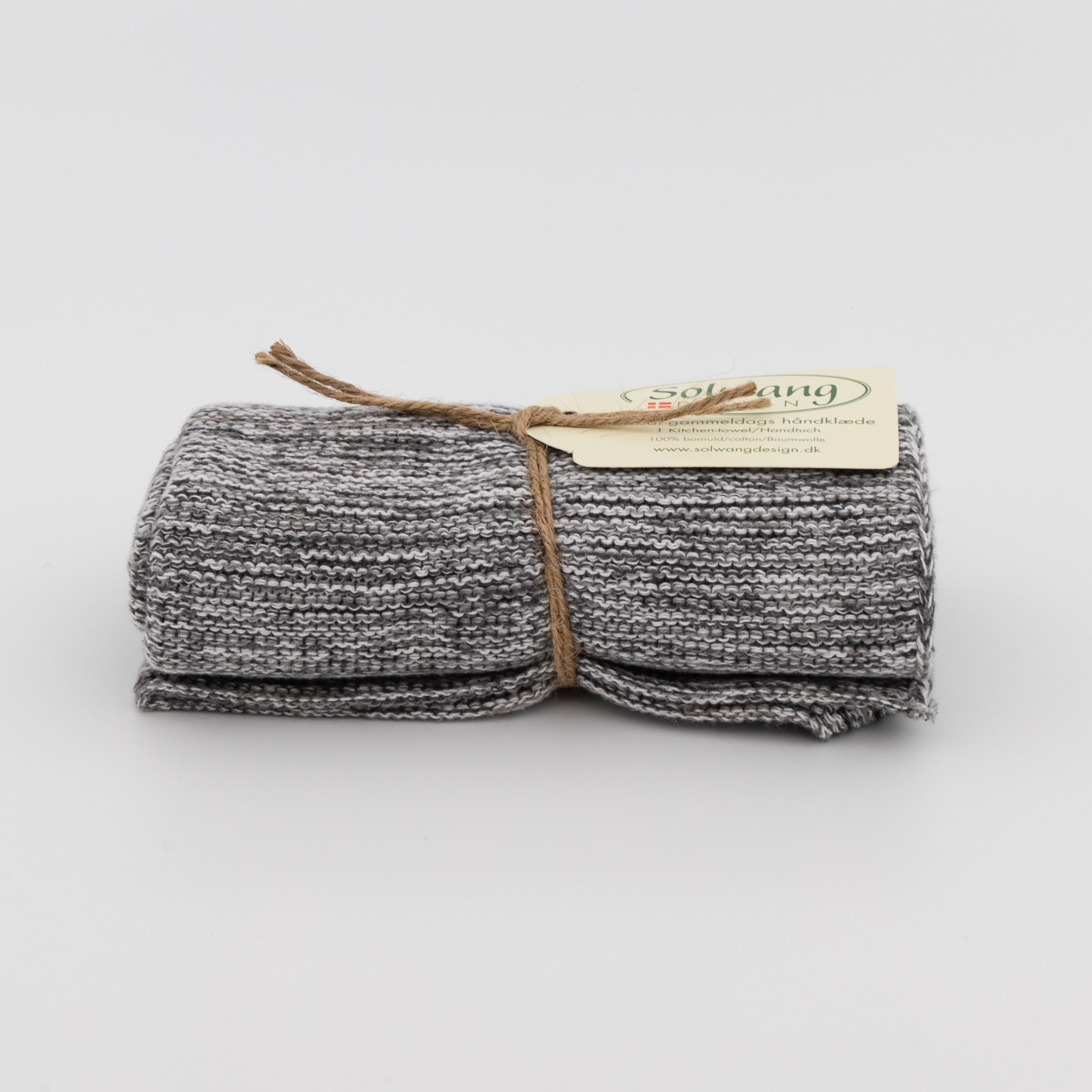 Zusammengerolltes Handtuch in grau.